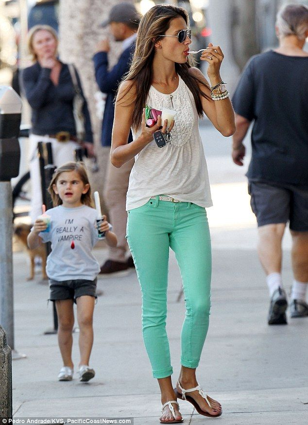 "Alessandra Ambrosio in mint & white ..... You didn't notice the little girl in the background with the ""I'm really a vampire"" shirt. ????"