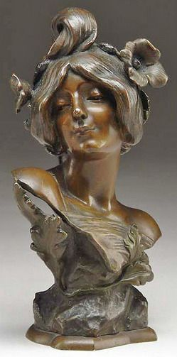 sculpture, France, A bronze Art Nouveau bust depicts beautiful woman with flowers adorning her hair. Signed on the side J. Causse. <...