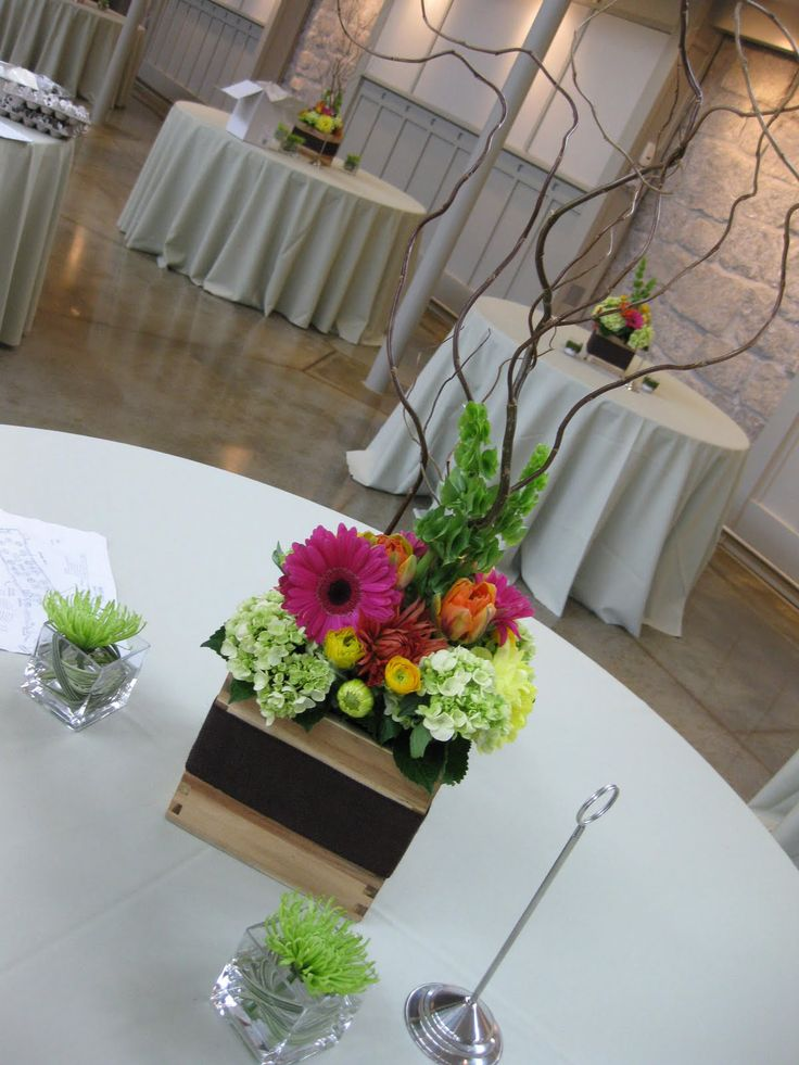 gerbera daisy centerpieces for weddings | Centerpieces of mini green hydrangea, curly willow, bells of ireland ...