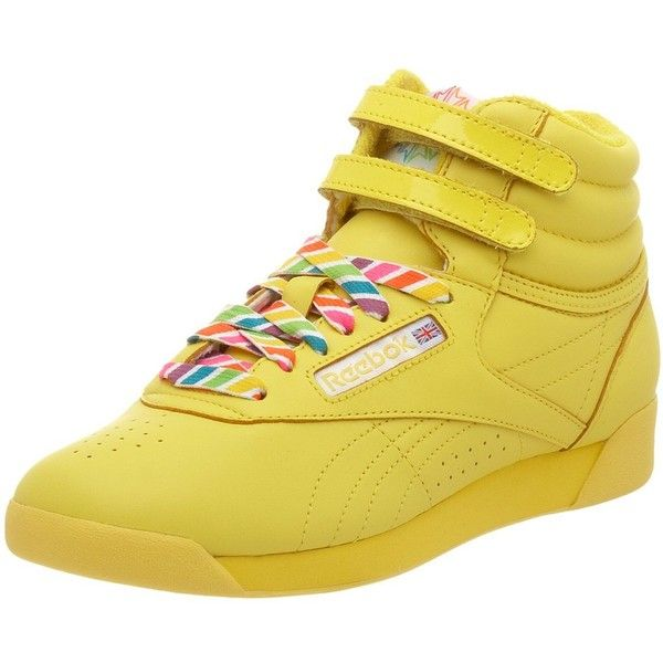 Reebok Women's Freestyle Hi Reign-Bow Sneaker ($60) ❤ liked on Polyvore featuring shoes, sneakers, reebok trainers, wide fit shoes, reebok, reebok sneakers and bow shoes