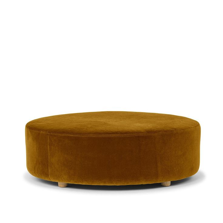 Luxurious velvet ottoman in gloriously large size! Sit back, put your feet up in style with this round statement piece, or easily converted into a center piece.