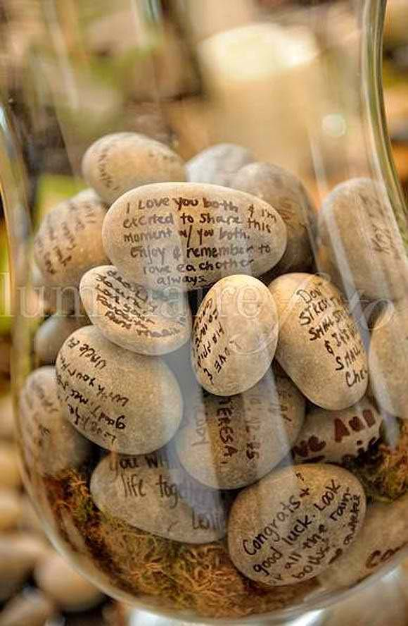 Love this idea. Let people who attend the wedding write on a stone provided and put it in a jar for the bride and groom to read after the wedding