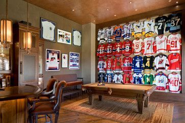 Whoever owns this house is a huge hockey fan. Some of the finest players of all time have jerseys on this wall. Love the pendant lights over the bar!