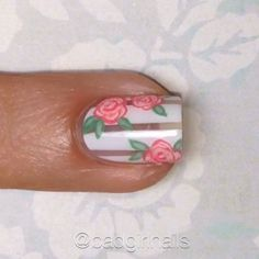 Tutorial for negative space floral nails, inspired by @just1nail 1⃣ Place striping tape (you can find it on Amazon or EBay) vertically on your nail. Paint over the tape with white polish and remove it immediately. 2⃣ Make a few imperfect blobs for your flowers. I used a medium peach polish and a dotting tool. 3⃣ With a darker shade of the same color make a dot in the center of the blob, then add small curves around it to create petals. Repeat this step with white or a light shade to add d...