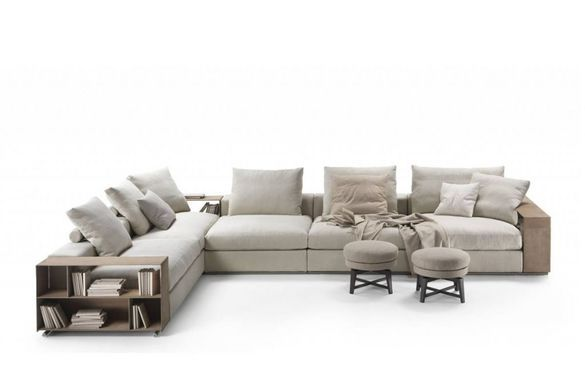The Groundpiece sofa is composed by a frame padded with polyurethane and metal insert, and by boxes (replacing the arms) made by metal covered with leather. The upholstery is available in removable fabric or leather.