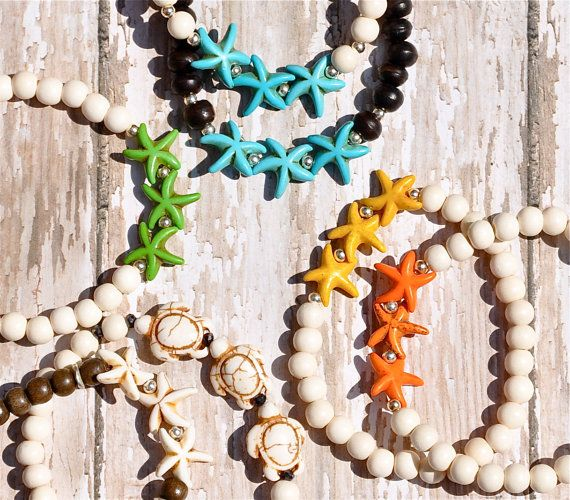 Starfish Bracelets / Starfish Bracelet / Starfish by BeadRustic, $22.00 each Starfish & whitewood/brown wood bead bracelets. Great for stacking.