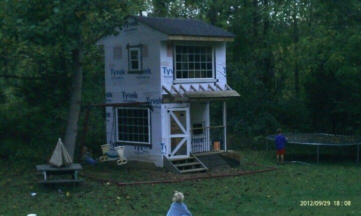 Two story playhouse with swingset attached play house for Playhouse with garage plans