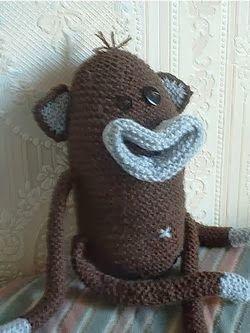 Monkey Knitting Pattern McNoodle Toy Knitting Pattern  A charmingly naive and funny monkey knitted pattern.  l really like the look of this creature, it would make a very personal gift to give to a child. #knitting #knittingpattern #amigurumi #toypattern