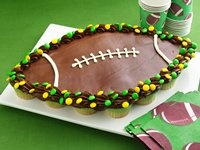 Football cupcake cake. You can take this idea and change the shape and colors and make what ever shape you want. You can also find instructions at http://www.ehow.com/how_2121953_make-cupcake-cake.html or http://www.ehow.com/how_4780747_ice-cupcake-cake.html
