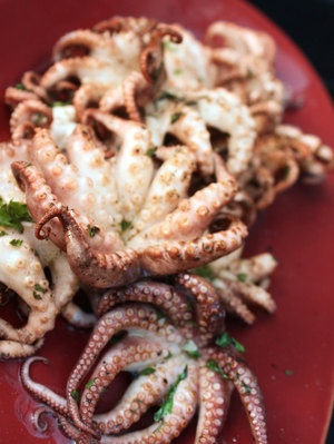 Grilled Baby Octopus.  I like this recipe because it is quick; you do not have to marinade the octopus overnight.