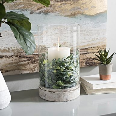 Our Morgan Cement Base Glass Hurricane is subtly industrial, but still delicate. This neutral candle holder makes a perfect accessory for any season.
