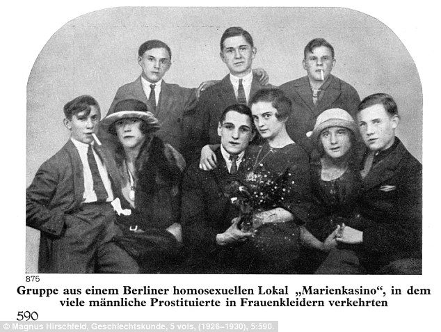 Transvestite prostitutes sitting on the laps of gay men in the popular Berlin gay bar Marienkasin