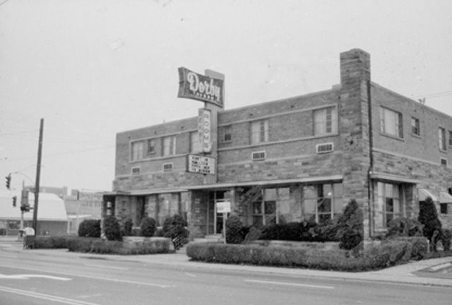 Derby Tavern on Queenston Road -- 126 Queenston Road. In the 1920's this tavern was called the Derby House, a wagon stop for traffic along a rough road that let to Niagara. Named after Mr. Derbyshire, the first owner, its second owner turned it into a larger complex in 1954. The Derby was a live country music hot spot in its heyday. It closed in 2009. This photograph was taken by J. Brian Henley, who at the time was an employee of the Hamilton Public Library.