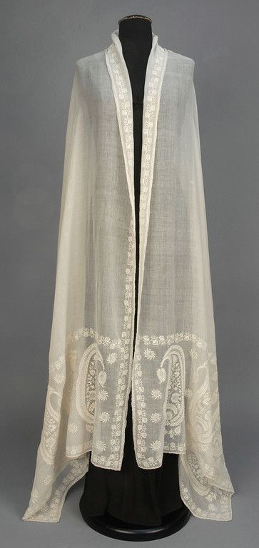 Long muslin rectangle, probably Bengali, having a serpentine border of vining strawberries in broderie Anglaise, and deep end borders with large elaborate botehs. 35 x 110. (1 1/2 inch tear near one end border, scattered small holes, few period mends) good. $960