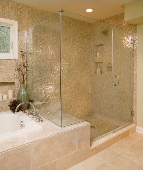 switch the shower stall for glass and tiled walls - also love that the tub ledge doubles as an in-shower bench seat because of where the glass is