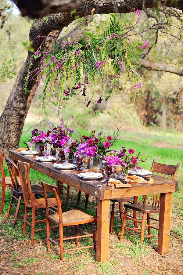 purple reception tablescape + hanging floral display, photo by Arina B Photography http://ruffledblog.com/purple-inspired-wedding-ideas #weddingreception #weddingideas