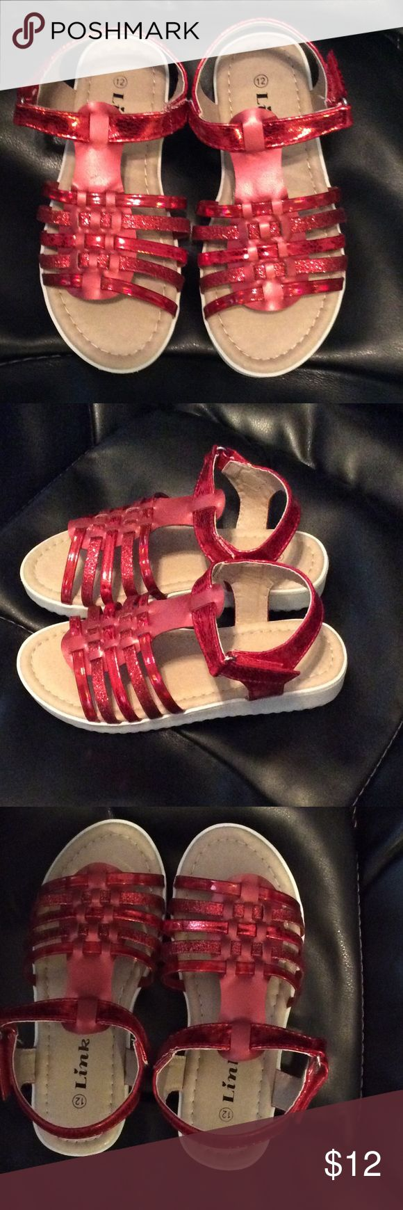 Links Kristen Red Girls Sandals Size 12 These are the ruby red slippers gone sandals! Glistening red strapped Girls sandals with rubber soles and hook and loop closure. Brand new in Box, Size 12 Links Shoes Sandals & Flip Flops