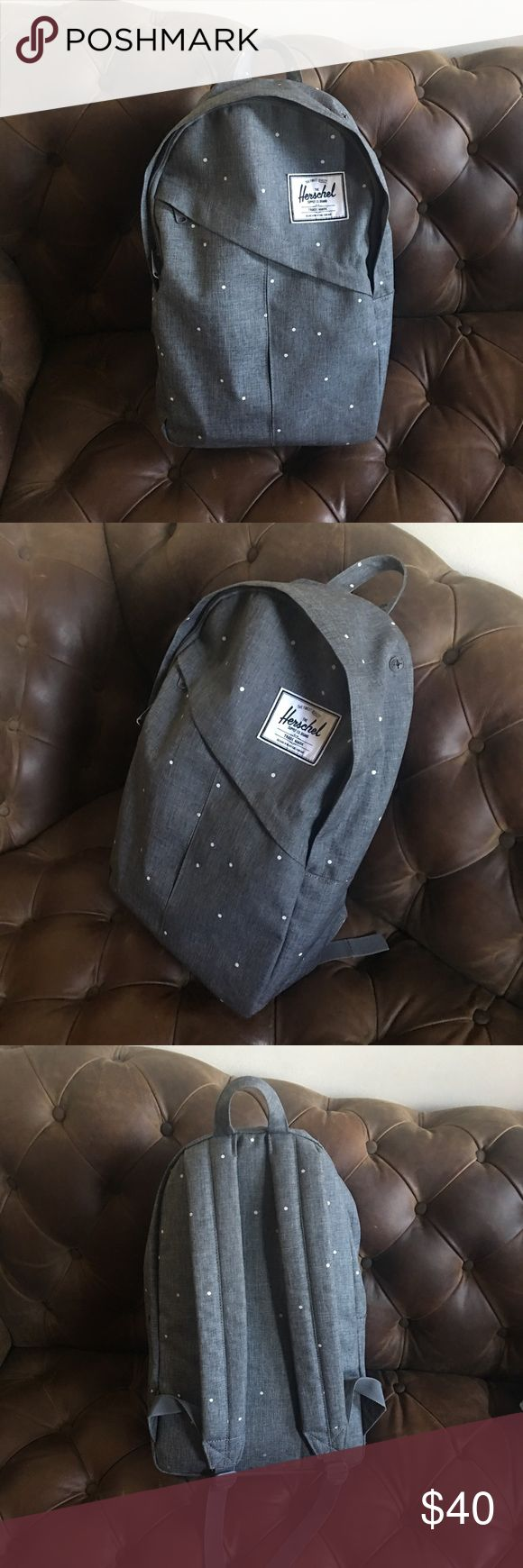 HERSCHEL HEATHERED DENIM POLKA DOT BACKPACK Gently used 3-4x. Excellent condition. Unique and cool heathered chambray/denim color with white polka dots. Unfortunately I have way too many backpacks and need to downsize. Perfect for school, hiking, and traveling. Has a large pocket where you can tuck a laptop in and a pen/pencil pocket on upper right side. This color is sold out everywhere! Best price on M. Herschel Supply Company Bags Backpacks