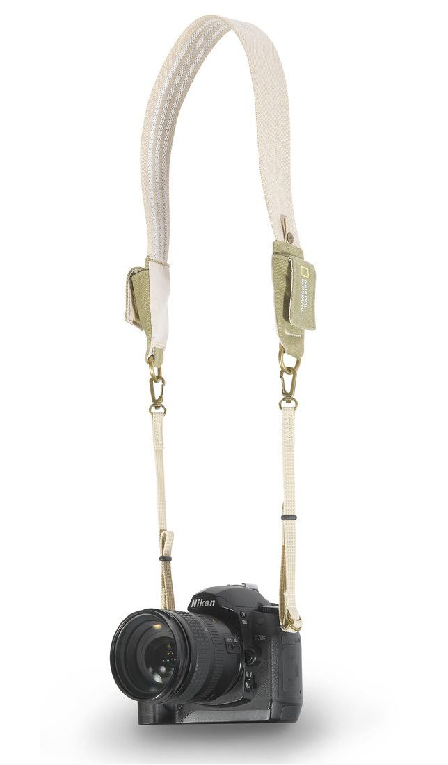 National Geographic NG-3030 Travel Camera Strap. The beige National Geographic NG 3030 Earth Explorer Travel Camera Strap is designed to carry a 35mm film or digital SLR camera. It will hold the SLR comfortably balanced around the neck. There are small pouches on the strap that can hold spare media and batteries. It has a small non-slip rubber grip that prevents the camera from slipping off the neck. The strap is made from environmentally friendly hemp. http://www.zocko.com/z/JKQ8E