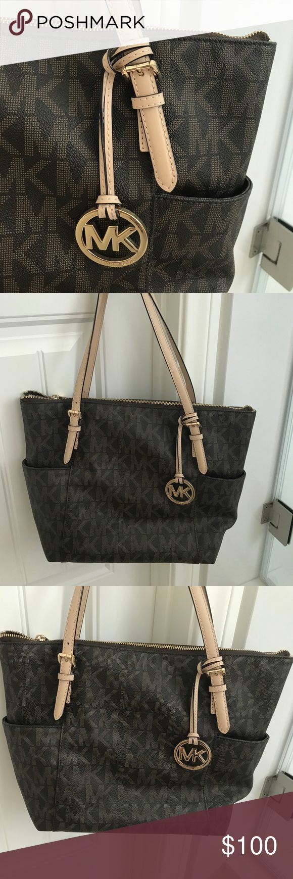 """Michael Kors Jet Set Monogram Tote, Leather Michael Kors Jet Set Monogram Leather Tote/Handbag. Brown leather with MK logos, tan handles, gold zippers. Interior is brown MK lining, large zipper pocket and two large phone pockets. Fit iPhone Plus no problem. Also two side pockets.   Lightly used. I'm very protective of my nice purses— no scratches, no marks, no wear, no tear- completely clean. Looks brand new. Leather still """"stiff"""" meaning lightly used but still new. KORS Michael Kors Bags…"""