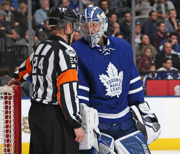 TORONTO, ON - JANUARY 19: Referee Graham Skilliter #24 chats with Frederik Andersen #31 of the Toronto Maple Leafs prior to a faceoff against the New York Rangers in an NHL game at the Air Canada Centre on January 19, 2017 in Toronto, Ontario, Canada. The Rangers defeated the Maple Leafs 5-2. (Photo by Claus Andersen/Getty Images)