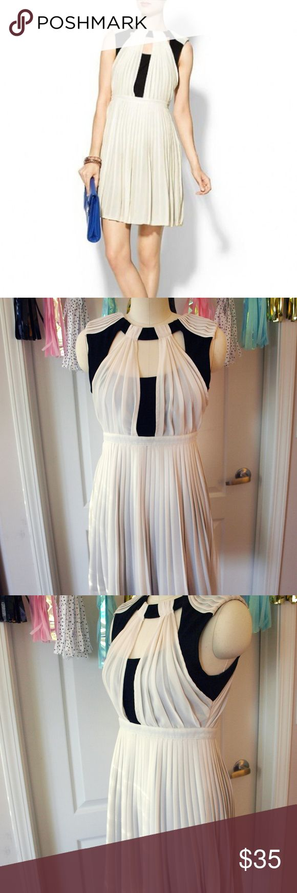 TINLEY ROAD Chic Pleated Cutout Dress Size Medium TRUE TO SIZE Gorgeous ivory pleated semi-sheer dress layered over a black sheath dress with a black slip skirt underneath. This dress has beautiful details on the bodice giving it a cutout effect. Used but in great condition, no visible flaws. Worn only maybe 3-4 times. Tinley Road Dresses