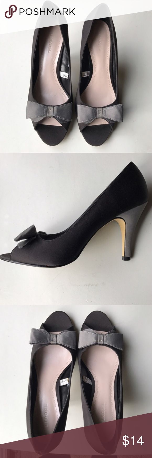 • Merona • black and silver colored heels Gorgeous peep toe heels with bow tie on upper. Satin style texture along the upper. Nice sturdy heel on these black and gray two toned heels. Leather sole. Elegant heels for many occasions. Merona Shoes Heels