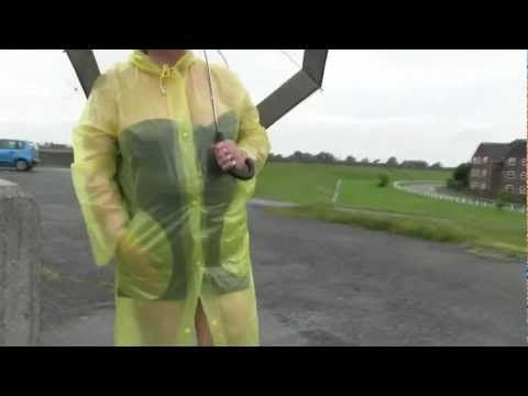 Colleen wearing her Yellow Mac at Canvey Island Essex in the rain - YouTube