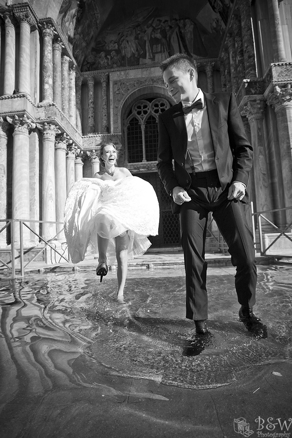 Venice bride wades thru the flooding.