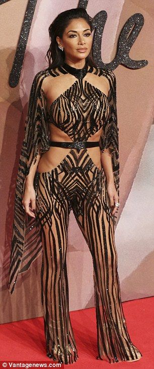 Bold: Kitty Cash wowed in a golden leaf print Kimono dress, while Nicole Scherzinger wore one of the raciest looks of the evening with this zebra-print inspired jumpsuit and cape