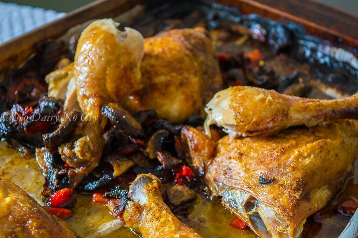 Roasted Chicken Legs and Backs with roasted red peppers, white and portabello mushrooms.