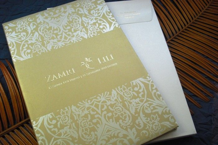 "Hard cover invitation with modern "" Batik "" pattern on the cover"
