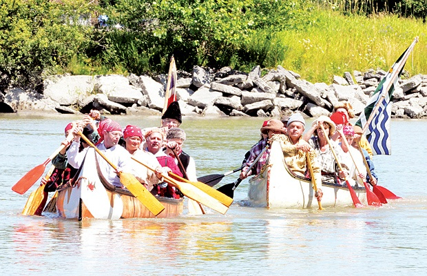 """The canoes coming into shore on """"Brigade Days"""". It is a great summer tradition in Fort Langley."""