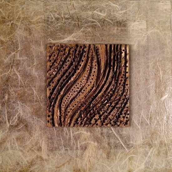 Sensum di Vincenzo Semeraro (tecnica mista su legno con henné, chicchi di caffè e curcuma, 20 x 20)