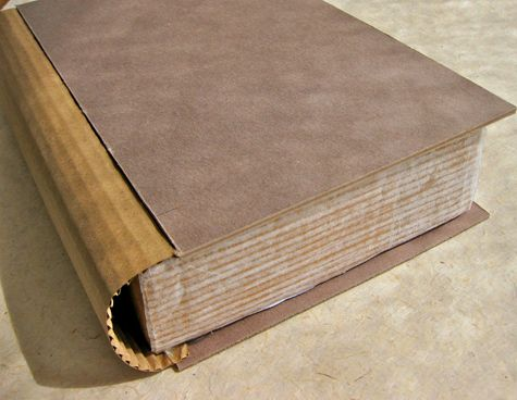 Cardboard Book How To-Turn a plain cardboard box into something that looks like a book. You can store it on a book shelf & hide things inside!!!!