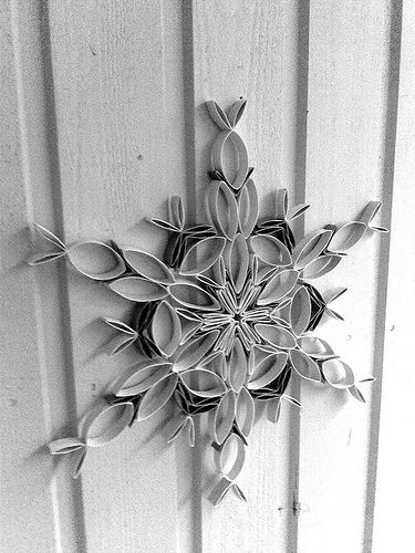 Snowflake wreath made with toilet paper rolls