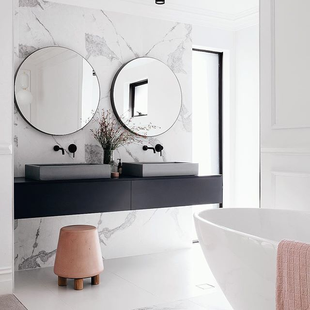 How amazing would it be to sink into some bubbles and chill in this gorgeous ensuite Shot by me for @adoremagazine in the stunning home of @mattandkimrescue . If you want to see more of this minimalist dream home it will be in the Spring issue, hitting newsagent shelves on Sept 7th #BlushConcrete #Omg