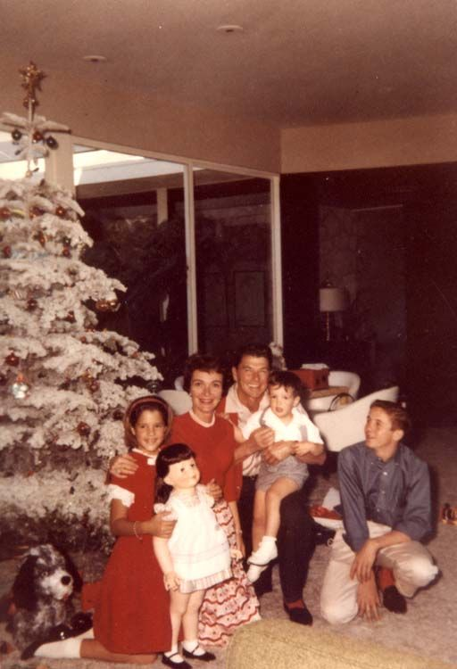Ronald Reagan, Patti Davis, Nancy Reagan, Ron Reagan and Michael Reagan in front of their Christmas tree at the Reagans' home in Pacific Palisades, California. (1960)