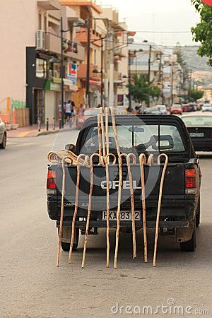 Sold shepherd's staves waits for customers in his car on the main street of Hersonissos. Crete, Greece