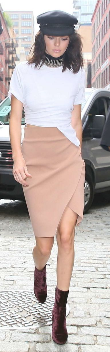 Kendall Jenner: Skirt, shirt, and shoes – Kendall and Kylie  Purse – Gucci  Necklace – Zimmermann