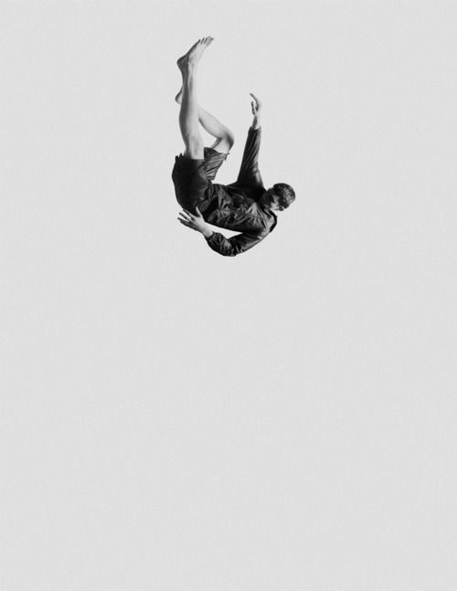 Man gracefully falling. Black and white photography.