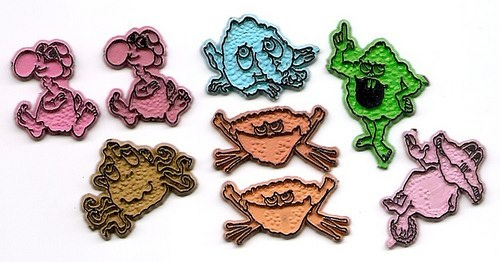 Freakies magnets! They came inside Freakies cereal and they were teh awesome! I remember the little purple guy on the far right stuck to our fridge.