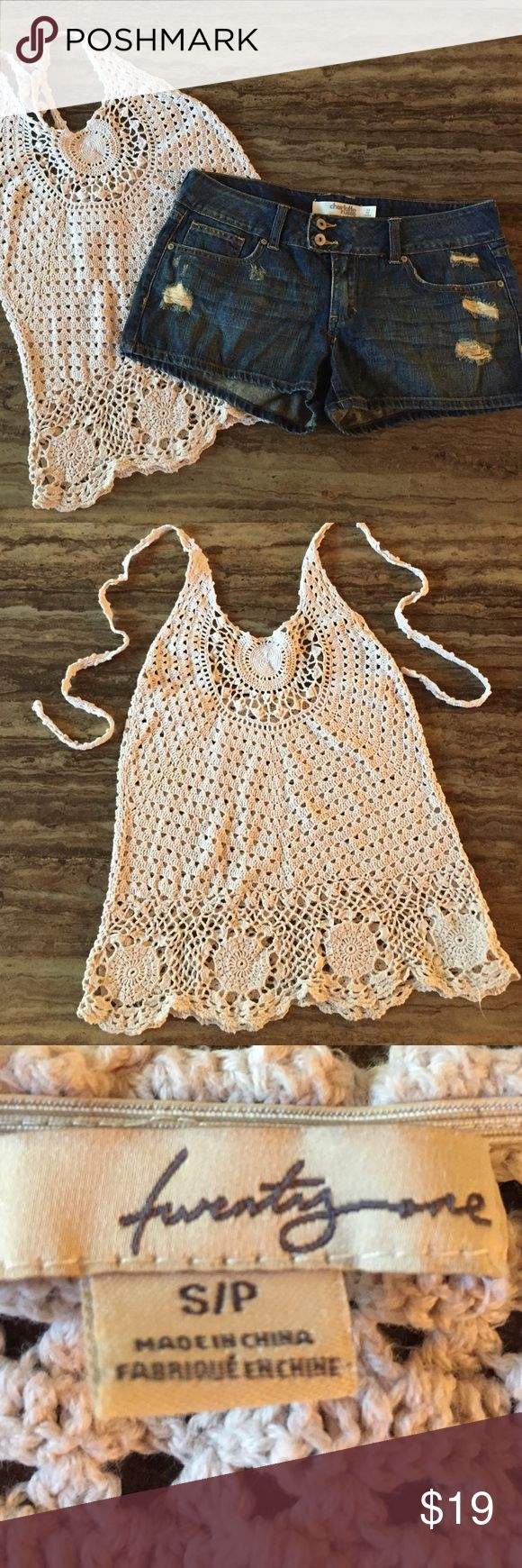 """CROCHET LACE HALTER TOP BY TWENTY ONE SIZE S/P This is a very cute crochet beige lace halter top.  It ties around the neck.  The flat chest measurement is 14 1/2 but has about 2 inch stretch. The length from about TOP of shoulder to bottom opening is 23-24"""".  100 % cotton hand wash cold.  Super cute preowned too.  See photos for more condition details.  TOP sold only in this listing.  Shorts sold in separate listing.  Thanks for looking.  Any questions please ask. twenty one Tops"""