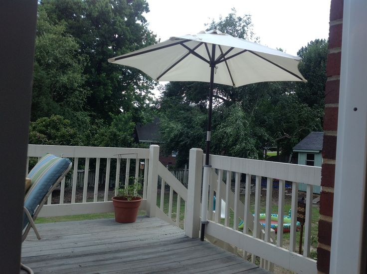 Need a different spot for your deck umbrella so there's shade when the sun moves? Try making a holder out of a piece of PVC pipe and mounting it to your deck rail with 2 u-shaped clips.