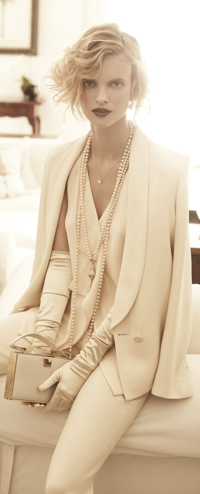 We're loving this perfect drape of the tuxedo blazer and blouse and the exquisite opera gloves to the soft white and the pearls