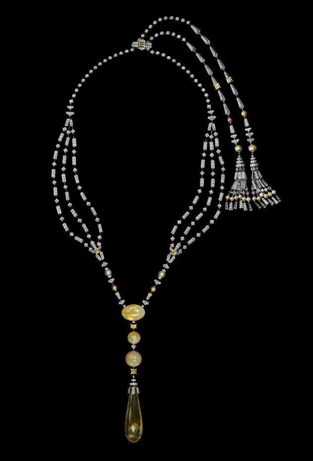 Platinum, one 48.46-carat briolette-cut beryl, cabochon-cut opals, yellow sapphires, natural pearls, baguette-cut, triangular-shaped, kite-cut and tapered diamonds, brilliants.