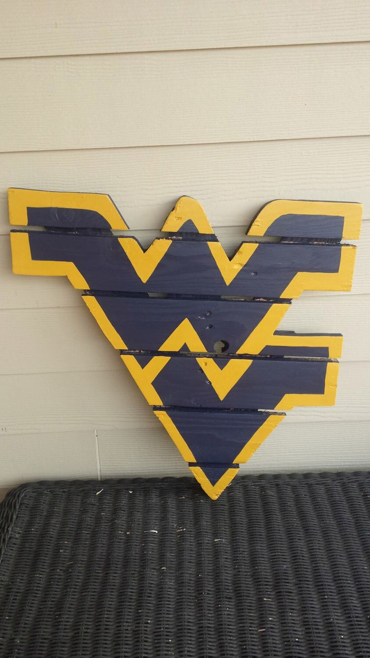 West Virginia Mountaineers sign made from recycled pallets, hand painted by MonicasFavThings on Etsy https://www.etsy.com/listing/245219193/west-virginia-mountaineers-sign-made