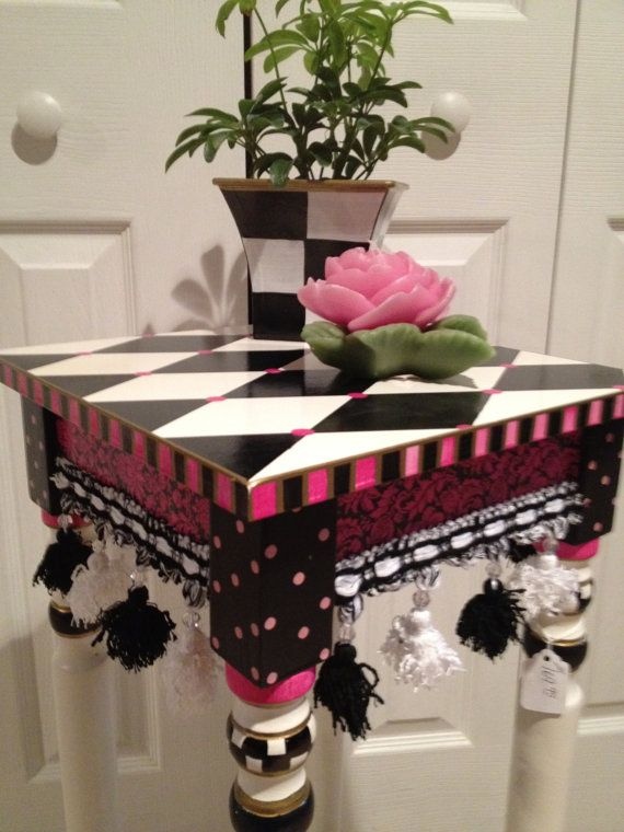 Alice in Wonderland Style.  Cute for side table in girls room....could use any accent color