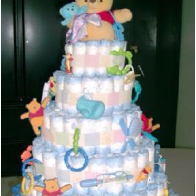 """• 60 diapers (depends on how big you make it) You can use either disposable or cloth - better find out what the expectant mother would like. You can use either white or patterned diapers.  • Ribbon, 1/2 or 1 inch wide, patterned to fit the baby shower theme. Pink, blue, or yellow are good choices.  • Ribbon, 1/4 inch to tie rolled diapers with  • 36-60 small rubber bands (depending on how you want to """"build"""" the cake  • 6 large rubber bands  • One 8-oz baby bottle or one large bottle of baby ...: Shower Ideas, Craft, Baby Shower Diapers, Gift Ideas, Diaper Cakes, Party Ideas, Baby Showers, Baby Stuff, Baby Shower"""