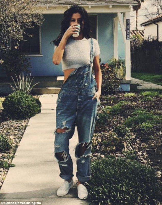Missing strap: Selena Gomez went for a country motif in her Instagram post on Saturday, strolling toward the camera in baggy, faded overalls